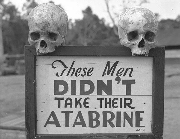 15-Valla-publicitaria-fomentando-la-Atabrine-medicina-anti-malaria-en-Papua-Nueva-Guinea-durante-WWII
